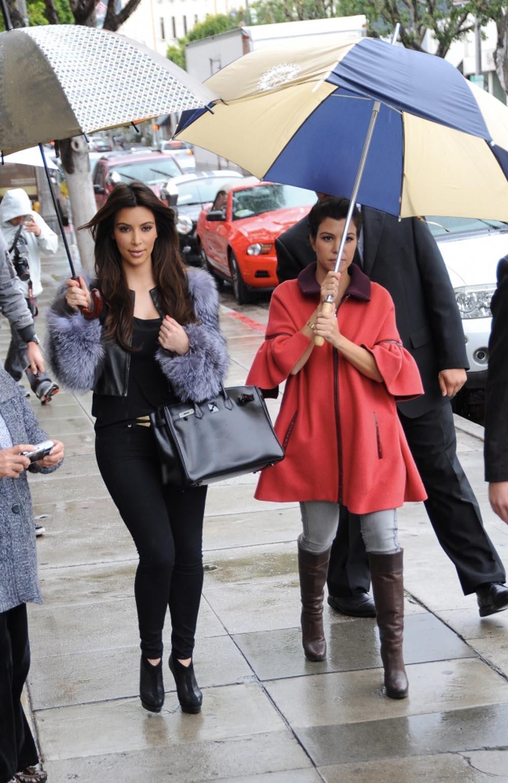 Kim and Kourtney Kardashian Brave the Rain in Beverly Hills