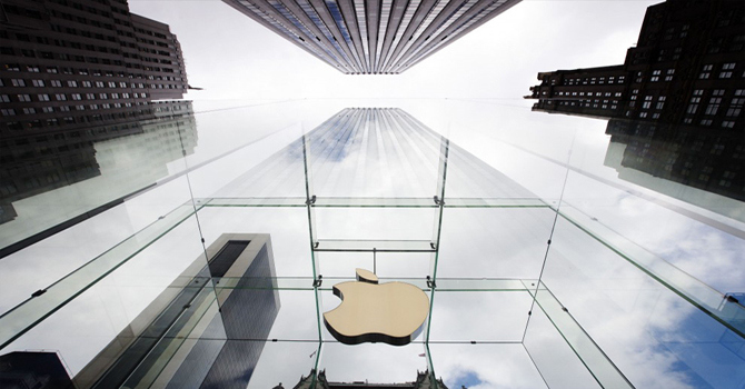 Apple falls on lower shipment forecasts