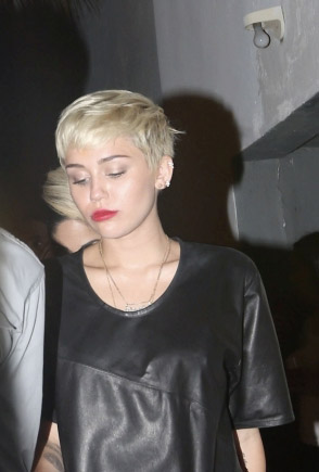 Miley Cyrus in night club