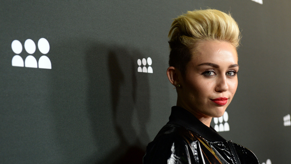 "Miley Cyrus Says She's ""Fine"" Following Parent's Divroce News"